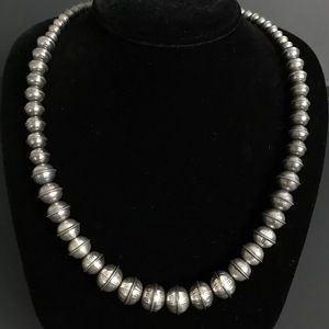 Jewelry - Graduated Stamped Navajo Pearls Necklace. 26 inch